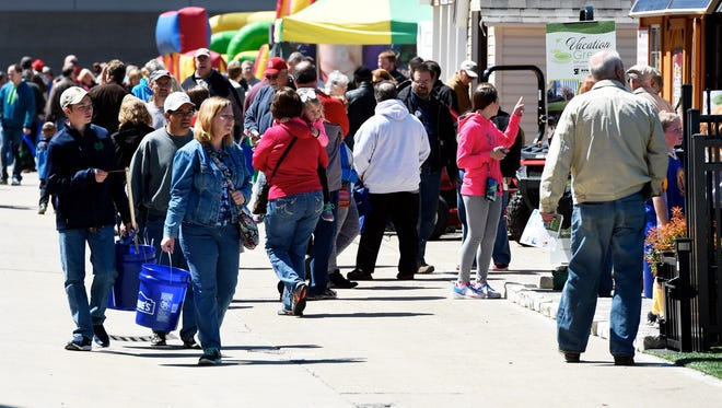 Attendees at last year's Heritage Federal Credit Union Home Show browse exhibits outside the Old National Events Plaza.