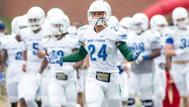 Trent Archie (24) and Argo teammates take the field prior to the UWF vs West Alabama playoff football game in Livingston, Alabama on Saturday, December 2, 2017.