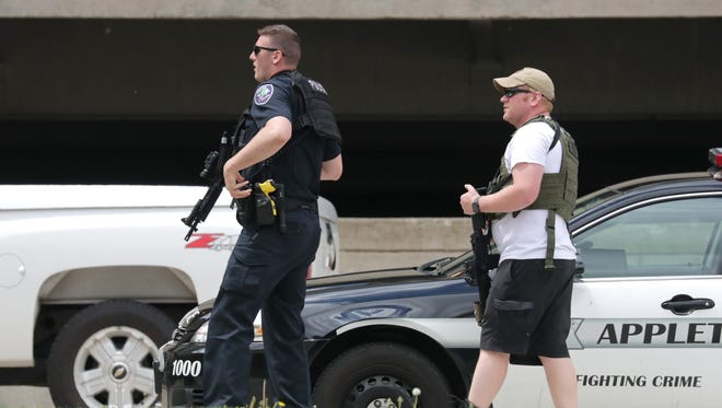 Police respond to downtown Appleton early Thursday afternoon for a report of an armed man. Appleton police Sgt. Dave Lund said police received several calls about a man who was carrying one or more guns in the area between the YMCA and the Blue Parking Ramp.