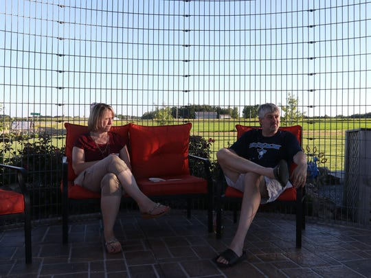 Sharon and Scott Gebelein, of Stratford, hang out on a Wine Wednesday at This & That Wisconsin Store in Stratford, August 17, 2016.