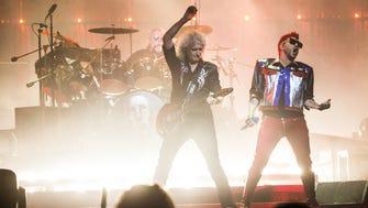 Queen guitarist Brian May plays as Adam Lambert rocks out during the Queen + Adam Lambert concert at Gila River Arena in Glendale, Ariz. on June 23, 2017.