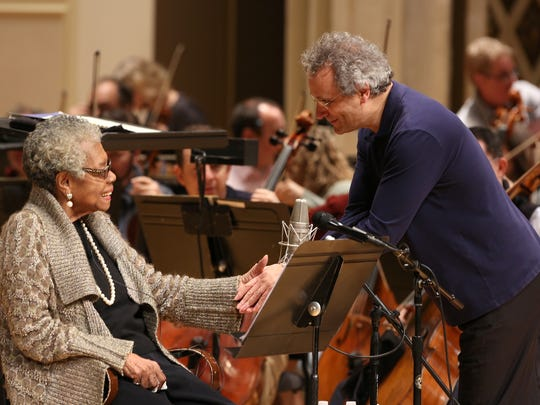 """Louis Langrée, right, music director with the Cincinnati Symphony Orchestra, greets Dr. Maya Angelou during rehearsal of Copland's """"Lincoln Portrait"""" for Langrée's inaugural weekend in November 2013. The orchestra is commissioning a work inspired by the poetry of Angelou, who died in 2014."""