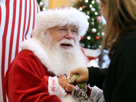 job shadow santa claus receives some assistance with duties at christmas - Christmas Assistance 2014