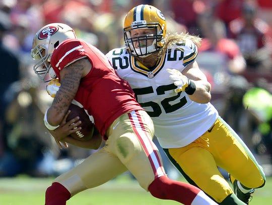 Packers linebacker Clay Matthews (52) sacks 49ers quarterback