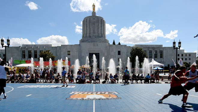 Teams compete during the Oregon National Guard Hoopla XVII at the Oregon State Capitol in Salem on Sunday, Aug. 9, 2015.