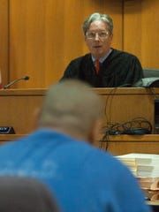 Ventura County Superior Court Judge Kent Kellegrew speaks to Joseph Salas during an August hearing to determine if he should be included on an injunction against the Southside Chiques of Oxnard.