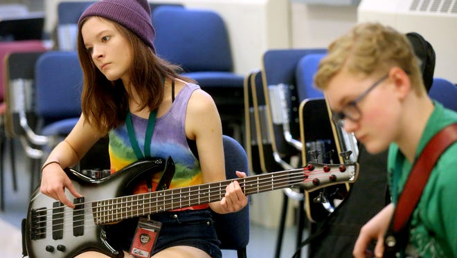 Caitlin McMahan, 15, plays bass during the Southern Girls Rock & Roll Camp at MTSU, on Tuesday July 26, 2016.