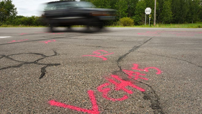 Painted markers on the pavement show skid marks and where vehicles came to rest Tuesday, August 2, on Minnesota Highway 23 and 160th Avenue near Foreston. Two people were killed in the five vehicle collision Sunday.