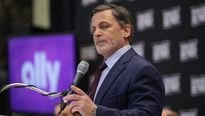 """Quicken Loans founder and chairman Dan Gilbert speaks during a news conference in Detroit on March 31, 2017. On Sunday, July 23, 2017, Gilbert issued a Facebook post apologizing for a """"tone deaf"""" ad campaign installed on a downtown Detroit building Friday, July 21, 2017."""