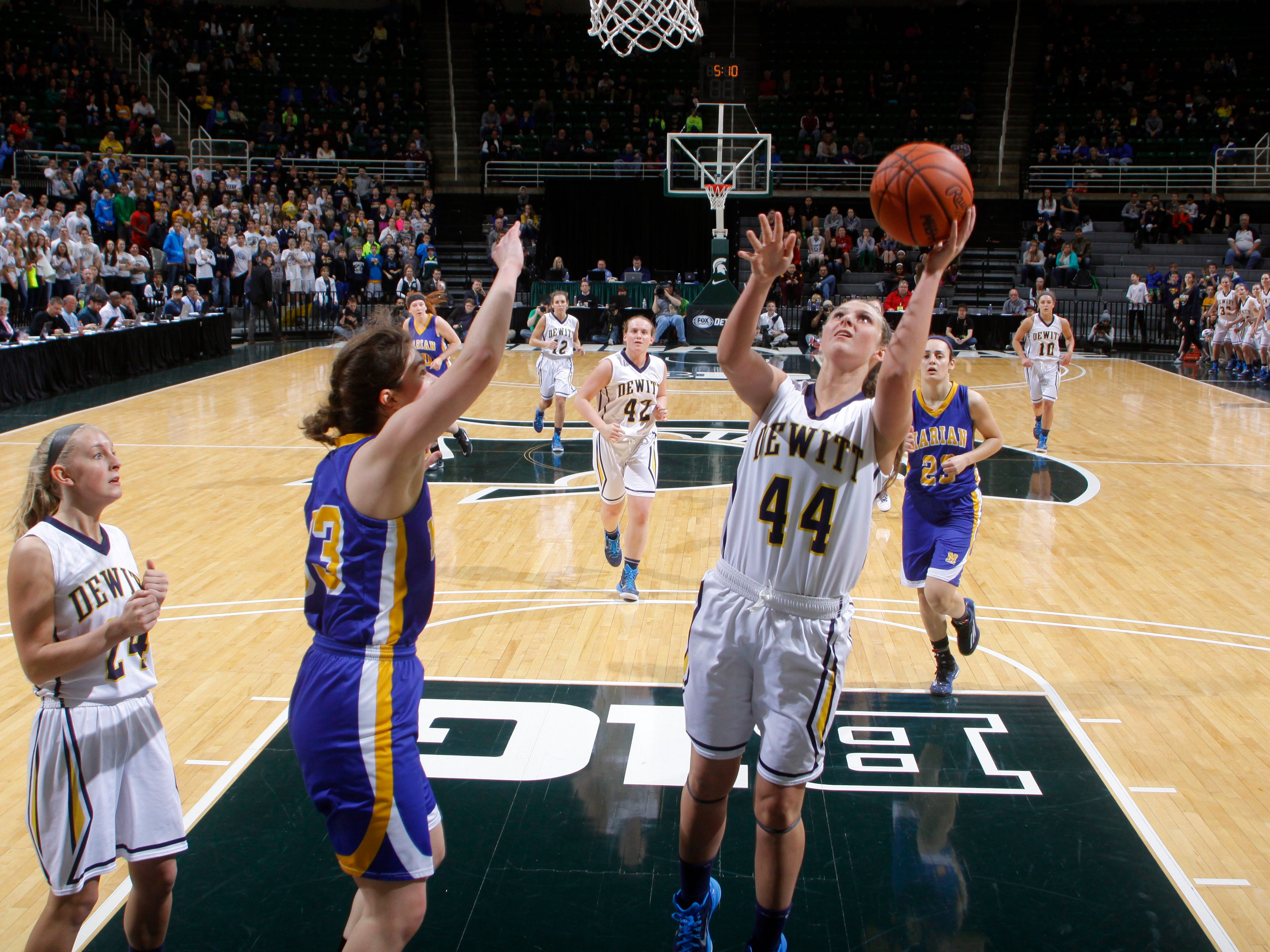 DeWitt's Lilly George (44) puts up a shot against Bloomfield Hills Marian's Kara Holinski during their MHSAA Class A championship game Saturday, March 21, 2015, at the Breslin Center in East Lansing, Mich. DeWitt fell 51-37.