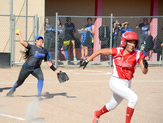 Dexter's Bryana Munoz throws to first base for a quick