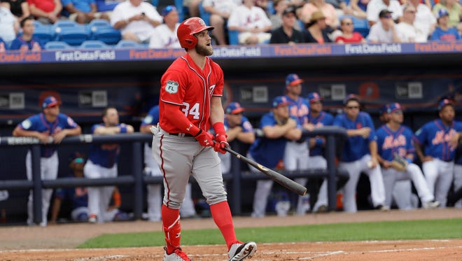 Bryce Harper hit a long solo homer and a single, helping the Washington Nationals to an 8-6 victory.