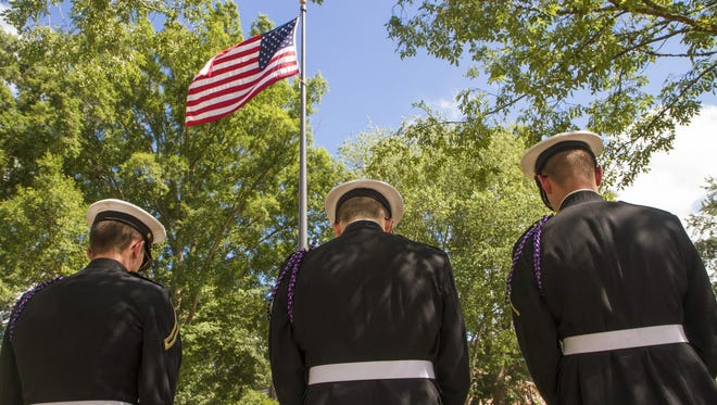 Cadets bow their heads at the 2015 Memorial Day service.