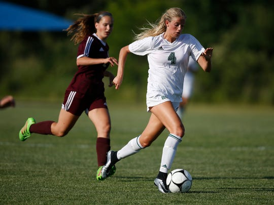 Iowa City West senior Regan Steigleder (4) breaks away with the ball against Dowling Catholic Thursday, June 8, 2017, during the 3A girls state quarterfinals at the Cownie Sports Complex in Des Moines.