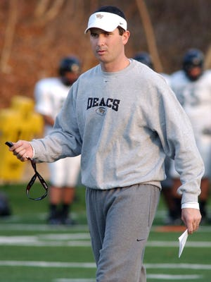 In this Dec. 9, 2006 file photo Tommy Elrod walks on the field while he was serving as assistant coach at Wake Forest University. Elrod, who has served as a radio announcer for the Deacons football games since 2014, has been identified by Wake Forest as the source of leaked game plans found at the University of Louisville.