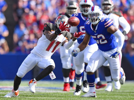 Tampa Bay Buccaneers' DeSean Jackson (11) catches a pass in front of Buffalo Bills' Preston Brown (52) during the first half of an NFL football game Sunday, Oct. 22, 2017, in Orchard Park, N.Y. (AP Photo/Rich Barnes)