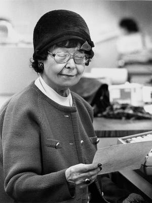 Ione Quinby Griggs looks at a reader's letter in this undated photo. Griggs' advice column ran for a half-century in The Milwaukee Journal's Green Sheet section.