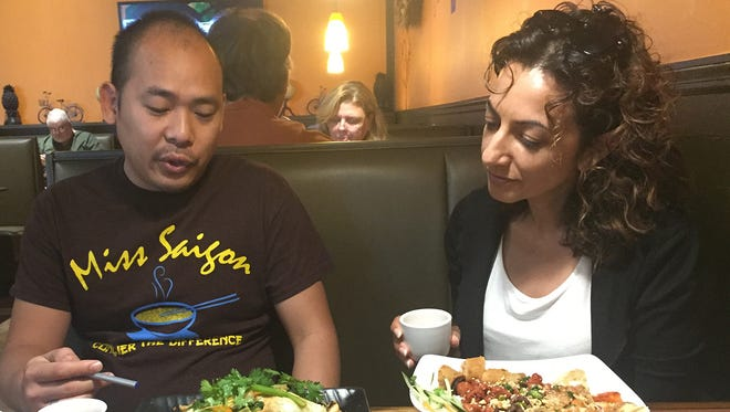 Renuka Christoph (right) with Ming Nguyen, manager of Miss Saigon,  a Vietnamese restaurant in Nashville.