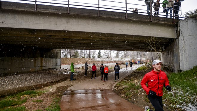 Runners in the Horsetooth Half Marathon join the Poudre Trail at Lions Open Space, in LaPorte, off Overland Trail.