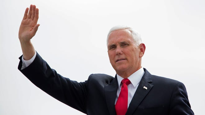 Vice President Mike Pence waves as he deplanes at an air force base in Guatemala City, on June 28, 2018. Pence was starting a trip to meet with the leaders of Guatemala, El Salvador and Honduras regarding immigration issues.