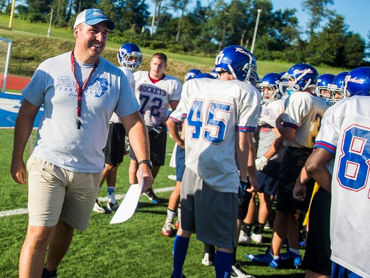 Spring Grove head coach Kyle Sprenkle works with his