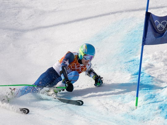 United States' Ted Ligety skis past a gate to win the gold medal in the men's giant slalom at the Sochi 2014 Winter Olympics, Feb. 19, 2014, in Krasnaya Polyana, Russia.