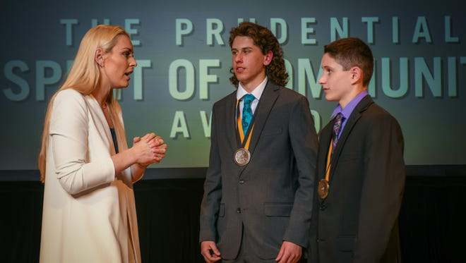 Evan Arnold, Neenah and Cole Stoffel, Appleton, receive personal congratulations from Olympic gold medalist Lindsey Vonn at a ceremony for the Prudential Spirit of Community Awards.