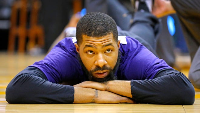 Phoenix Suns forward Markieff Morris (11) stretches prior to a game against the Golden State Warriors on Wednesday,  Feb. 10,  2016 in Phoenix, Ariz.