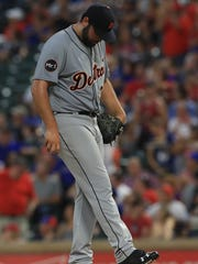 Tigers first baseman Michael Fulmer reacts after giving up a home run in the third inning on Monday, Aug. 14, 2017, in Arlington, Texas.