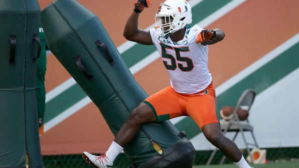 FILE - In this Aug. 5, 2016, file photo, Miami linebacker Shaquille Quarterman runs a drill during the NCAA college football team's practice, in Coral Gables, Fla. The Hurricanes have such high hopes for freshman linebacker Shaquille Quarterman that they already have him in the starting lineup. (AP Photo/Alan Diaz, File)