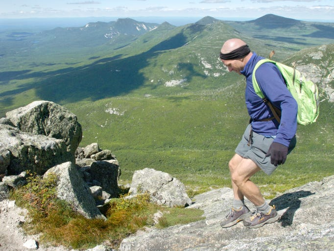 Joe McMaster walks on the summit of Mount Katahdin,