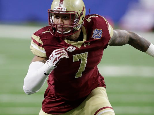 File-This Dec. 26, 2016, file photo shows Boston College defensive end Harold Landry rushes the line during the first half of the Quick Lane Bowl NCAA college football game in Detroit. Landry was named to the AP Preseason All-America Team on Tuesday, Aug. 22, 2017. (AP Photo/Carlos Osorio, File)