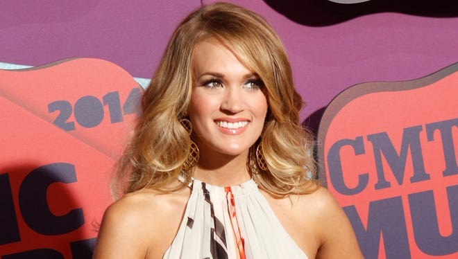 """Carrie Underwood arrives at the """"2014 CMT Music Awards"""" in Nashville, Tenn. Underwood has five nominations in three categories for this year's awards."""