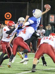 Blanchet quarterback gets off a pass under heavy pressure in a 32-12 win against Clatskanie in the first round of the OSAA Class 3A state playoffs on Saturday, Nov. 7, 2015.