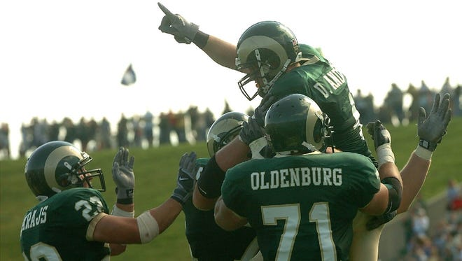 Clint Oldenburg and teammates lift up receiver David Anderson in celebration of a CSU touchdown during a 2004 game at Hughes Stadium. Oldenburg said he has fond memories of his time playing for CSU and coach Sonny Lubick at Hughes, which is in its final season as home to the Rams.
