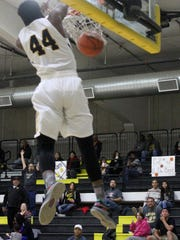 Alamogordo's Dee Smith excites the crowd with a dunk during the second quarter on Tuesday night.