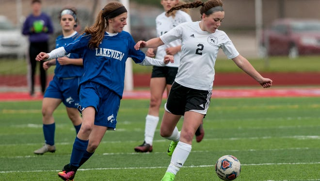 Marine City's Lauren Morris gets ahead of Lakeview defenders during a soccer game Friday, May 19, 2017 at East China Stadium.