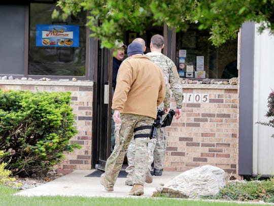 Law enforcement officials at Midamar, 1105 60th Avenue SW, during a federal investigation in southwest Cedar Rapids, Iowa, on Tuesday, May 12, 2015.