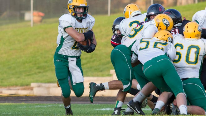 Ryan Ferguson of Pennfield rushes through the gap in Marshall's defensive line.