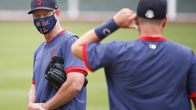 Red Sox manager Ron Roenicke has been wearing a mask on the field at Fenway Park.