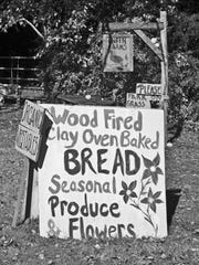 This hand-painted sign appears in front of the wood shed where The Bread Lady sells her clay-oven baked breads along Sunset Boulevard.