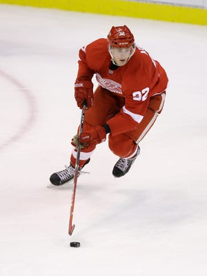 Detroit Red Wings left wing Louis-Marc Aubry controls the puck against the Chicago Blackhawks on Sept. 25, 2014.