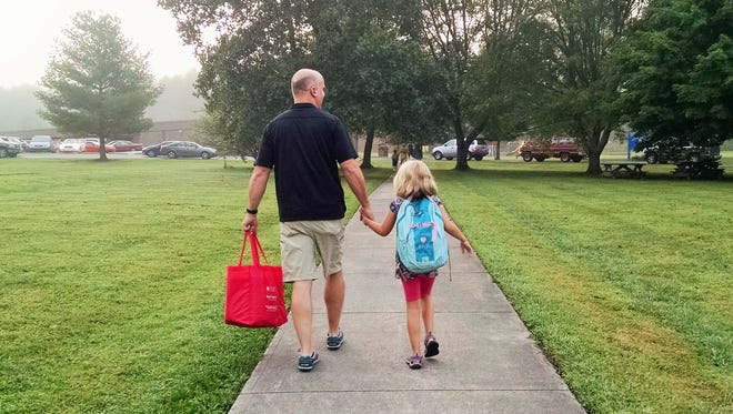 My husband and older daughter, on their way to school.