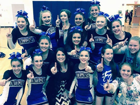 Fort Defiance's competition cheer team celebrates the
