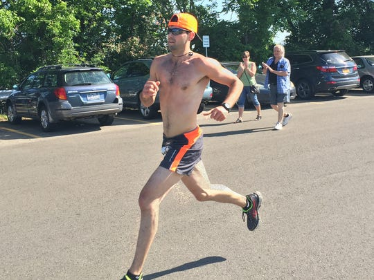 Steve Esposito of Binghamton finishes third at the Vestal XX on Saturday in 1 hour, 17 minutes and 59 seconds.