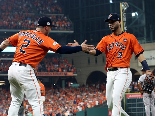 Houston Astros third baseman Alex Bregman (2) and Houston Astros left fielder Marwin Gonzalez (9) celebrate after a play during the fifth inning against the New York Yankees during game one of the 2017 ALCS playoff baseball series at Minute Maid Park on Friday, Oct. 13, 2017.