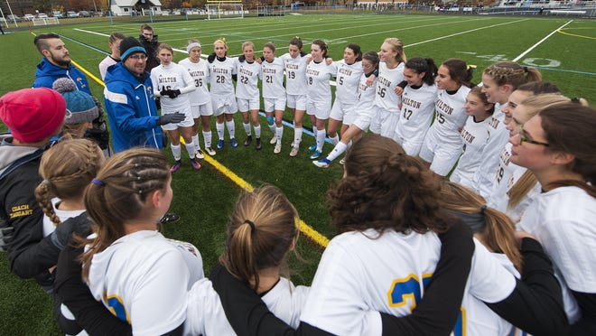 Milton head coach Cory Payson talks to the team during the Division II girls soccer championship game between the Montpelier Solons and the Milton Yellowjackets at South Burlington High School on Saturday.