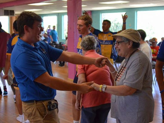 A member of the Journey of Hope/Ability Project dances with Irma DeLeon at the group's annual friendship visit to Adaptive Recreation Services.