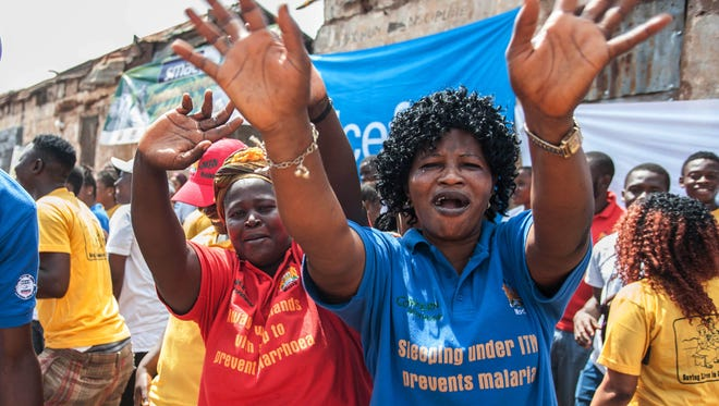 Women in Sierra Leone celebrate this month when their country was declared Ebola-free in the city of Freetown. Neighboring Guinea, the last place where the epidemic smoldered, is counting the days to learn whether it will be free of the disease.