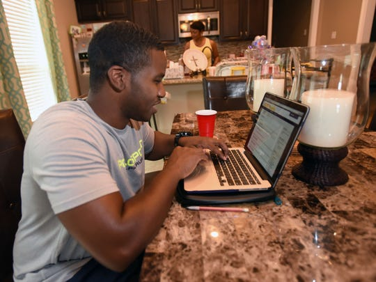Christopher Mahone works on his Masters in Business